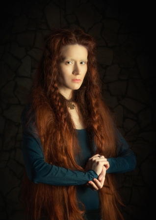 Portrait of young woman with long red hair  Image stylized as old picture