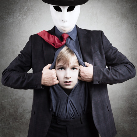 Man in mask showing his Inner child, psychological concept