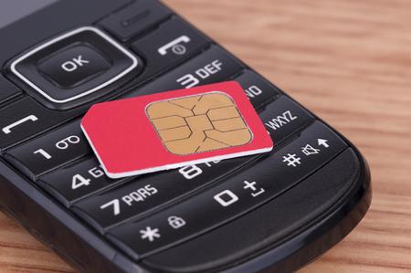 Photo pour SIM Card over the Phone on the table - image libre de droit