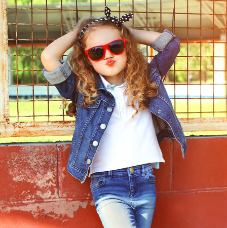 Photo pour Fashion portrait little girl child in jeans jacket, red sunglasses posing in summer day - image libre de droit