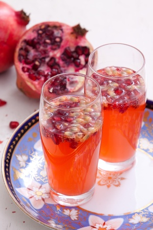 A fresh spritzer made from watermelons, club soda and pomegranate seeds