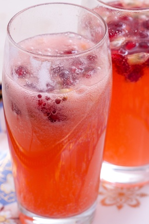 A fresh spritzer made from watermelons and pomegranate seeds