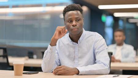 Photo pour African Businessman Sitting in Office Thinking - image libre de droit