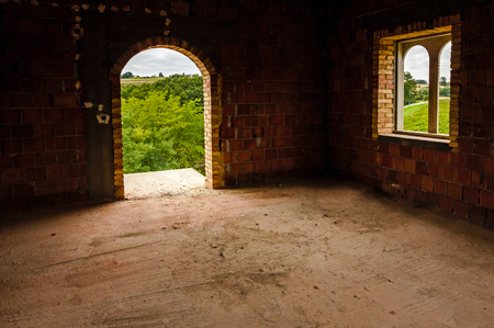 Nice arched door in new built structure with view on forest.