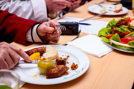 Judges will assess best sausages with fresh vegetables that are exposed on traditional sausage tournament.