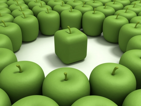 Green apple of the cubic form in an environment of usual green apples.