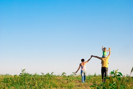 happy family in a meadowの写真素材