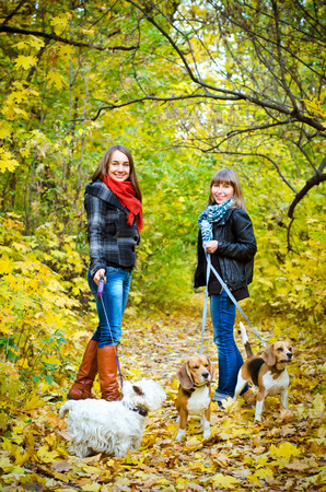 women walking in the park with dogs