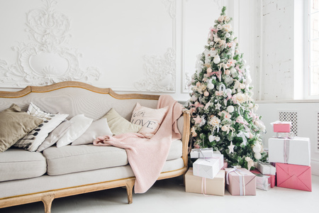 Photo for Christmas tree with a white sofa in a white room. - Royalty Free Image