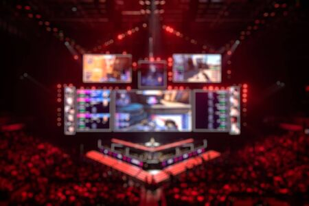 Photo pour Blurred background of an esports event - Main stage venue, big screen and lights before the start of the tournament. - image libre de droit