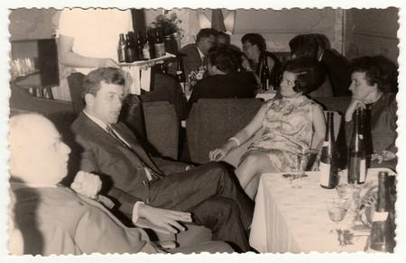 THE CZECHOSLOVAK  SOCIALIST REPUBLIC, 1960: Vintage photo shows a group of people in a restaurant, 1960s.