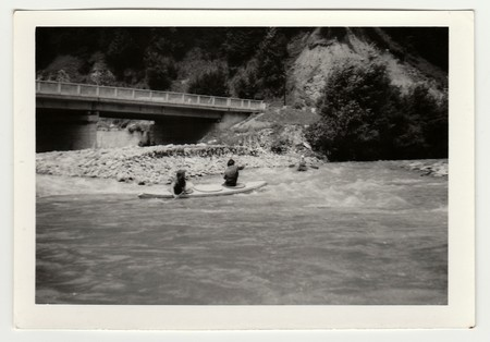 THE CZECHOSLOVAK SOCIALIST REPUBLIC - CIRCA 1980s: Vintage photo shows young canoeists on the river.のeditorial素材