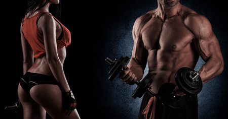 Foto de young beautiful couple, bodybuilding, posing in front of the camera, sexy, strong - Imagen libre de derechos