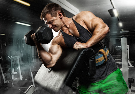 execute exercise with dumbbells, on bkack background
