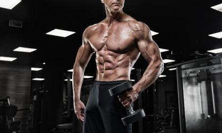 Brutal strong athletic men pumping up muscles workout bodybuilding concept background