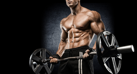 Photo pour strong and handsome young man doing exercise with dumbbells - image libre de droit