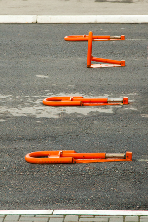 Orange parking barriers in the parking lot near the Russian store.