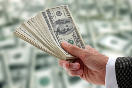hand of businessman holding dollars
