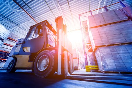 Photo for Forklift loader in storage warehouse ship yard. Distribution products. - Royalty Free Image