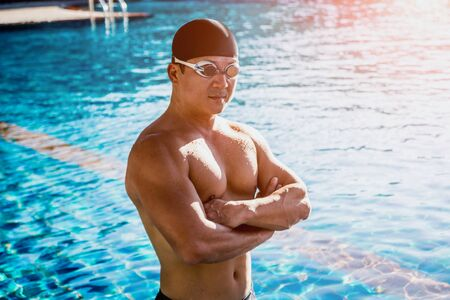 Photo for Young athletic man swimming in the swimming pool. Active sport - Royalty Free Image