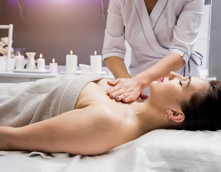 Photo for Beautiful young woman enjoying massage in spa salon. Cosmetology concept - Royalty Free Image