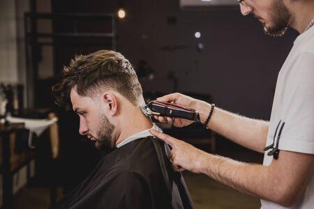 Foto für Young man with trendy haircut at barber shop. - Lizenzfreies Bild