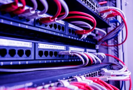 Photo pour Network switch and cables in red and white colors. Data Center - image libre de droit