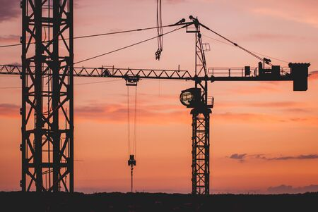 Photo pour Construction crane silhouettes at sunset. Industrial background - image libre de droit