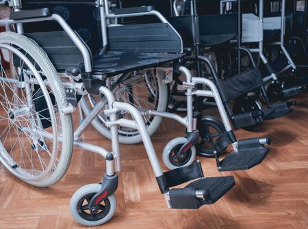 Empty wheelchairs at the hospital. Light Background.
