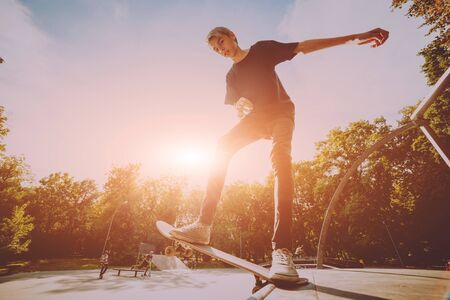 Photo for Young skateboarder in the park. Beautiful background. - Royalty Free Image
