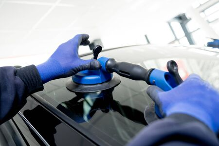 Photo for Automotive glazier equipment for replace windscreen. In auto service - Royalty Free Image