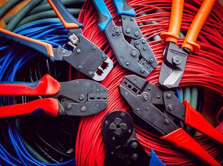 Photo pour Electrical equipment. Electricity cable and crimper. Background - image libre de droit