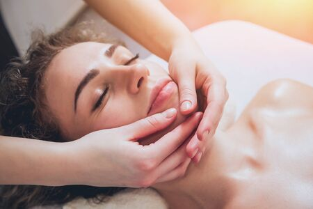 Foto de Beautiful woman in spa salon getting facial massage - Imagen libre de derechos