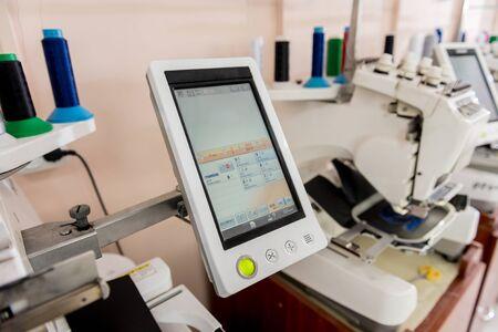 Photo pour Fabric industry production line. Textile factory. Working tailoring process - image libre de droit