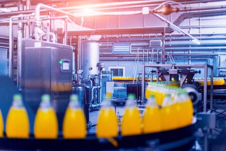 Photo pour Beverage factory interior. Conveyor with bottles for juice or water. Modern equipments - image libre de droit