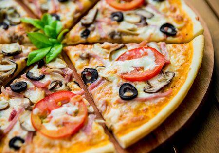 Photo pour Large pizza on a wooden table. Restaurant - image libre de droit