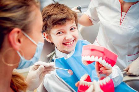 Foto de Little boy at the dental office. Calm and happy. - Imagen libre de derechos