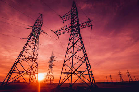 Photo pour High-voltage power lines at sunset. Electricity distribution station. Background - image libre de droit