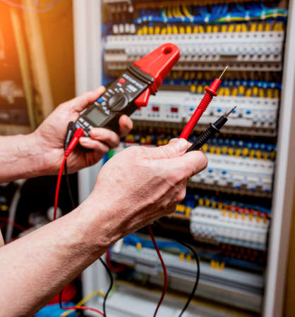 Photo for Electrical measurements with multimeter tester. Electrical background - Royalty Free Image