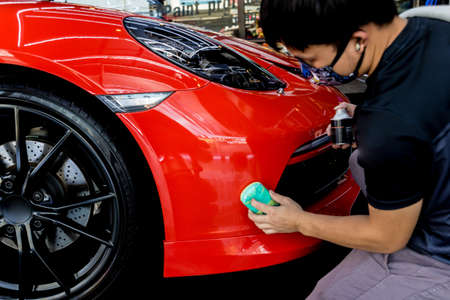 Photo for Car service worker applying nano coating on a car detail - Royalty Free Image