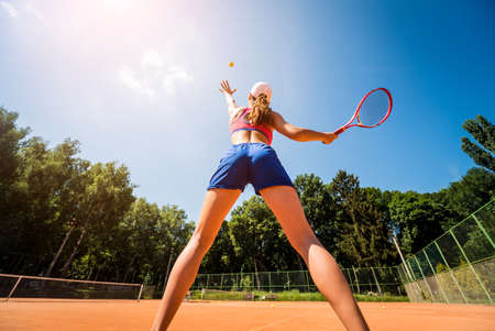 Photo for Young athletic woman playing tennis on the court. - Royalty Free Image