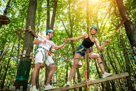 Photo for Young couple having fun time in adventure rope park. - Royalty Free Image