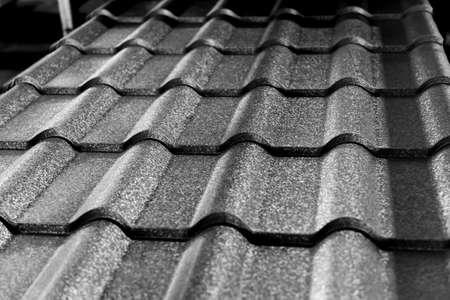 Photo pour Gray metallic roof tiles background with light pattern. - image libre de droit