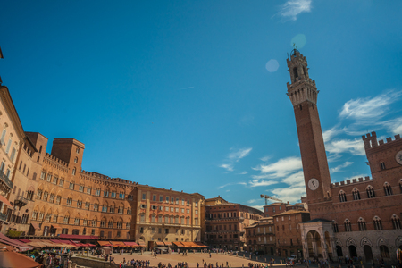 Panorama of Siena, Tuscany, Italy. Piazza del Campo with Palazzo Pubblico and its Torre del Mangia. Beautiful image of medieval italian town.