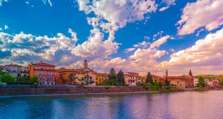 Photo pour Verona, Italy. A scenic panoramic view of the river of Adige and its embankments on a cloudy and bright day - image libre de droit