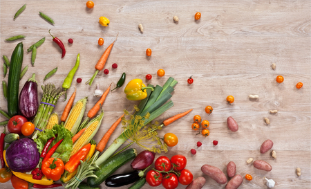 Healthy food background - studio photography of different fruits and vegetables on wooden table