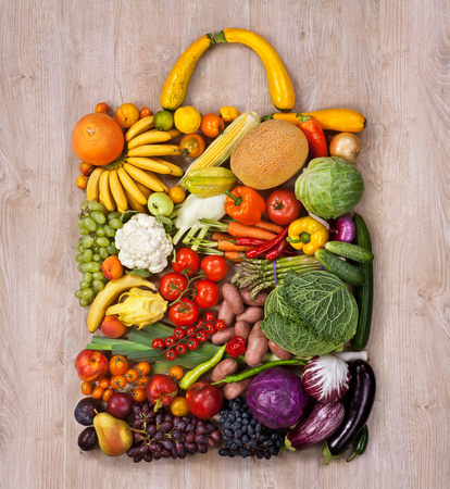 Healthy food shopping - food photography of designer handbag made from different fruits and vegetables on wooden table