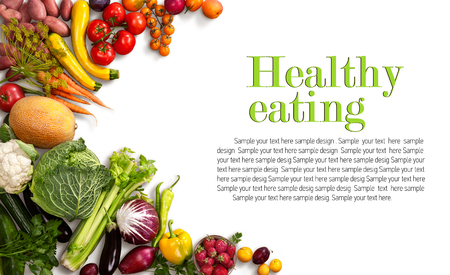 Healthy eating background - studio photo of different fruits and vegetables on white backdrop