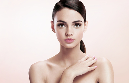 Pretty young lady with professional make-up, skin care concept - photoset of attractive brunette girl on beige background