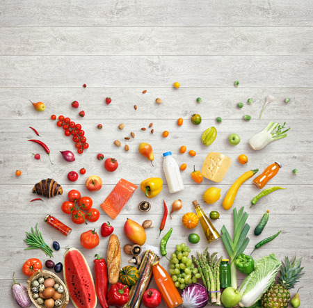Healthy food background. Studio photography of different fruits and vegetables on white wooden background, top view. High resolution product.